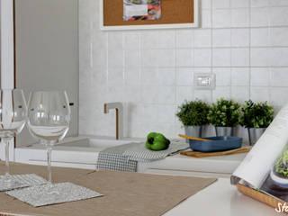 Modern style kitchen by staged interiors Modern