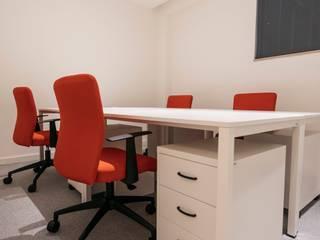 Remodelação e decoração escritórios Braga por IC interiores Moderno
