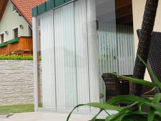 Wintergarten Anbau aus Holz und Glasschiebewänden Schmidinger Wintergärten, Fenster & Verglasungen Moderner Wintergarten Glas Transparent