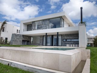 Detached home by CIBA ARQUITECTURA