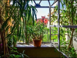 Casa Brio Giardino d'inverno eclettico di Arabella Rocca Architettura e Design Eclettico