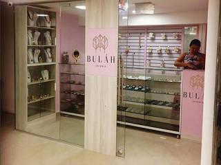 Local Bulah: Espacios comerciales de estilo  por Diseñador Paul Soto