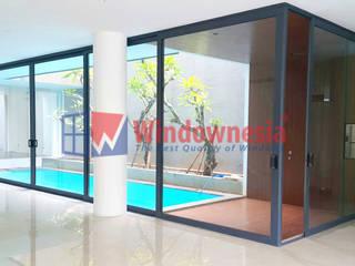 Pintu Geser Aluminium:  Ruang Fitness by PT. Podomoro Windownesia