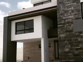 FACHADA: Casas de estilo moderno por Kombo Creativo