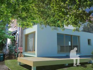 A l'arrière un volume minimaliste vient étendre la construction existante pour y créer une cuisine et préserver l'organisation intérieure de la maison.:  de style  par 3B Architecture