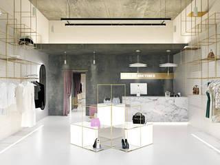 BOUTIQUE EN BARCELONA: Espacios comerciales de estilo  de La Pecera Estudio Creativo
