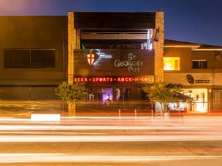 Pub em São Paulo Bares e clubes industriais por Estudio Piloti Arquitetura Industrial