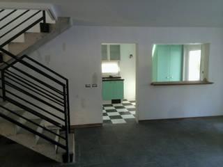 128_CasaVirgo_Vivienda: Livings de estilo  por Rakau Construcción + Arquitectura