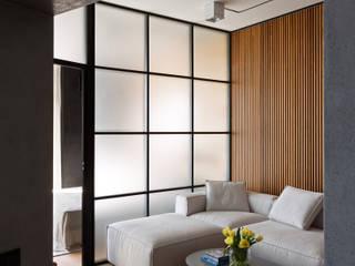 Дизайн-проект практичной квартиры в стиле лофт, площадью 90 кв.м. Москва, Проспект Вернадского: Гостиная в . Автор – Квадрат
