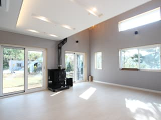 고급스러움에 모던함을 더한 레트로스타일 전원주택 인테리어: (주)디엘건축의  거실