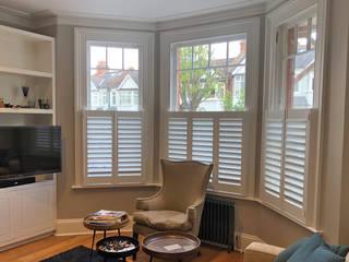 Style Meets Functionality in South West London Plantation Shutters Ltd Ruang Keluarga Modern Kayu White