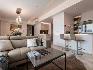 Design & Build: Melrose Condominium:  Living room by erstudio Pte Ltd
