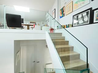 casa ARNAL: Estudios y despachos de estilo  de costa+dos