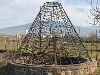 Rund: Terraços  por Atelier ferro quente