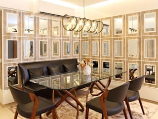 Dr.Bhavisha's Residence - Modern full interior renovation:  Dining room by Chawla N Associates
