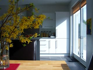 Kitchen and dining area.:  Kitchen by Jim Morrison Architects