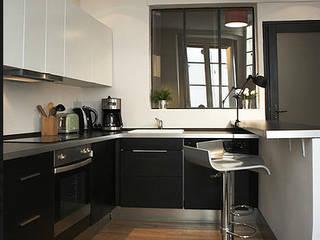 Appartement 75006 Paris: Cuisine de style  par 2002