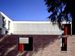 MUNICIPIO A TRUCCAZZANO: Case in stile  di Arco Associati srl