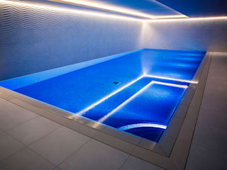 Smaller spaces can have beautiful pools London Swimming Pool Company Infinity Pool Concrete Beige