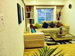 Salas de estilo moderno de The D'zine Studio Moderno