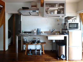 一人暮らし~キッチン: 志田建築設計事務所が手掛けたキッチン収納です。