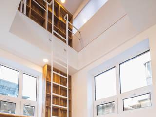 Salas modernas de AAPA건축사사무소 Moderno
