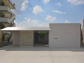 イリバルのコートハウス モダンな 家 の 久友設計株式会社 モダン