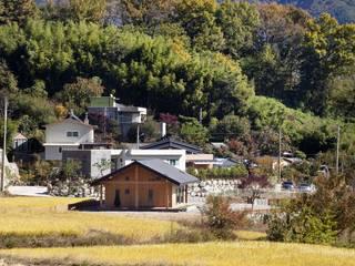 Casas de estilo  de (주)하우스스타일