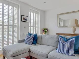 A Striking Look for Two Living Rooms in a Kennington Home Plantation Shutters Ltd Ruang Keluarga Klasik Kayu White