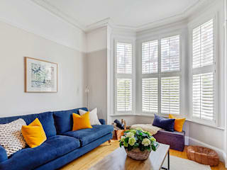 Two Styles for Two Different Spaces Plantation Shutters Ltd Ruang Keluarga Modern Kayu White