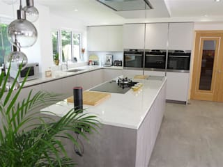 Impeccable Concrete Pearl Grey Kitchen with Center Island: modern Kitchen by PTC Kitchens