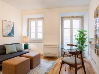Apartamento c/ 1 quarto - São Bento, Lisboa: Salas de estar  por Traço Magenta - Design de Interiores
