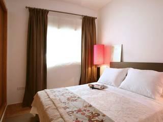 Pancho R. Ochoa Interiorismo BedroomAccessories & decoration Copper/Bronze/Brass Beige