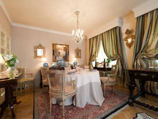 Pancho R. Ochoa Interiorismo Dining roomCrockery & glassware Copper/Bronze/Brass Amber/Gold