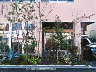 尼崎のデザイン事務所 / 鉄骨造3階建て 事務所+テナント+トレーニングジム: 一級建築士事務所 Coo Planningが手掛けた家です。,