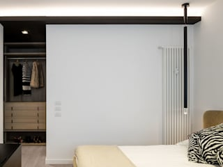La camera padronale: Camera da letto in stile  di Patrizia Burato Architetto