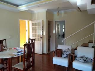 Reforma de sala de estar e área externa por Daniela Ponsoni Arquitetura Eclético