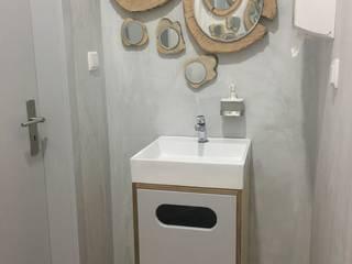 Espelhos e lavatórios:   por Inês Florindo Lopes