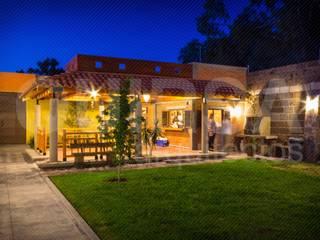 Jardín Naranjos: Terrazas de estilo  por QUIRSA arquitectos