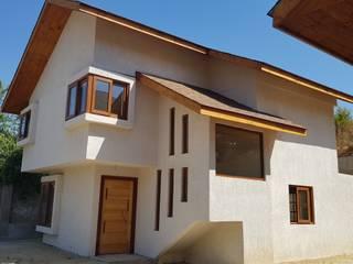 Habitar la ladera: Casas unifamiliares de estilo  por Andes Arquitectura & Construcción