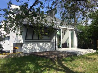 Dom Wola Justowska : styl , w kategorii Domy zaprojektowany przez ANNA KOSMALA