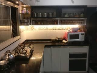 Mrs. Sunita's Kitchen Renovation:  Built-in kitchens by Mahajan Architectural Studio