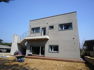 Houses by 인우건축사사무소, Modern