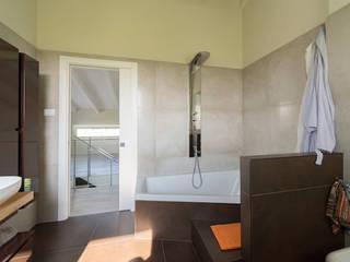 casa in legno abbiategrasso:  in stile  di Novello Case in Legno