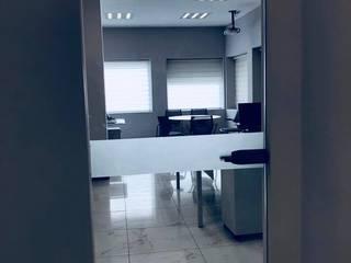 CANCELERIA-CRISTAL TEMPLADO: Oficinas y tiendas de estilo  por C+G ARQUITECTURA
