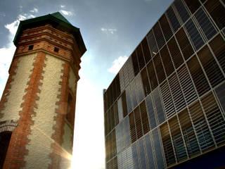 Oficinas y bibliotecas de estilo moderno de Dintel arquitectura y construcción Moderno