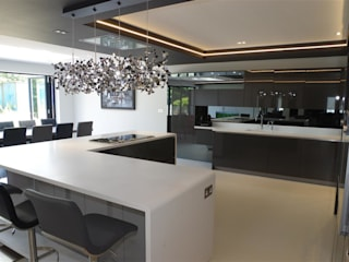 A Luxurious Living Space in Designer White: modern Kitchen by PTC Kitchens
