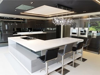A Luxurious Living Space in Designer White:  Kitchen units by PTC Kitchens