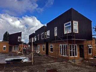 Condominio Don Rene. Osorno, Región de los Lagos.: Condominios de estilo  por NidoSur Arquitectos