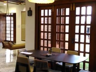 Dining Area:  Dining room by Tulika Design Studio